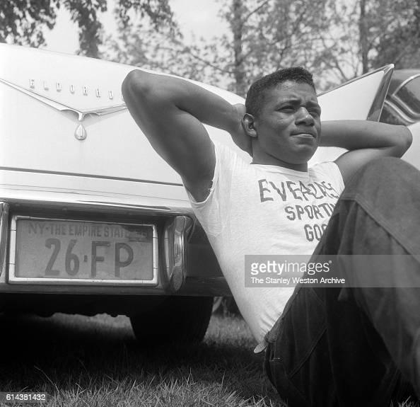 Floyd Patterson poses with his Cadillac Eldorado at his training camp on May 12 1956 at Greenwood Lake New York