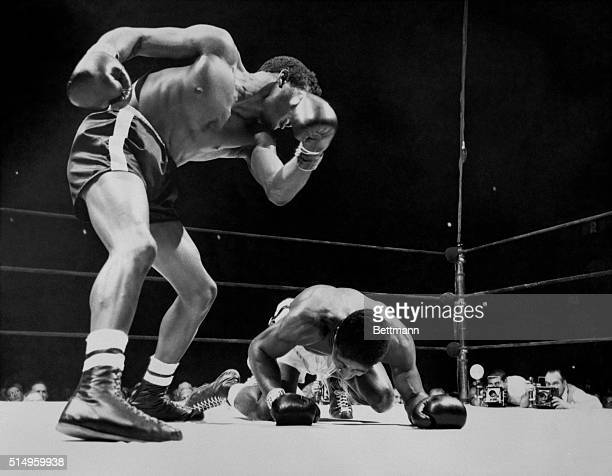 Floyd Patterson young Lightheavyweight contender from Brooklyn NY gazes down at Jimmy Slade after flooring the New York Heavyweight contender during...