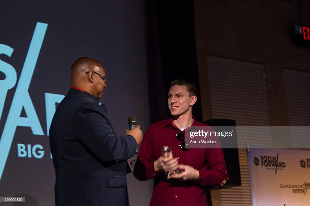 Floyd Webb awards Callum Cooper onstage during the GE / Focus Forward - Short Films Big Ideas Filmmaker Competition Awards Ceremony - 2013 Park City on January 22, 2013 in Park City, Utah.
