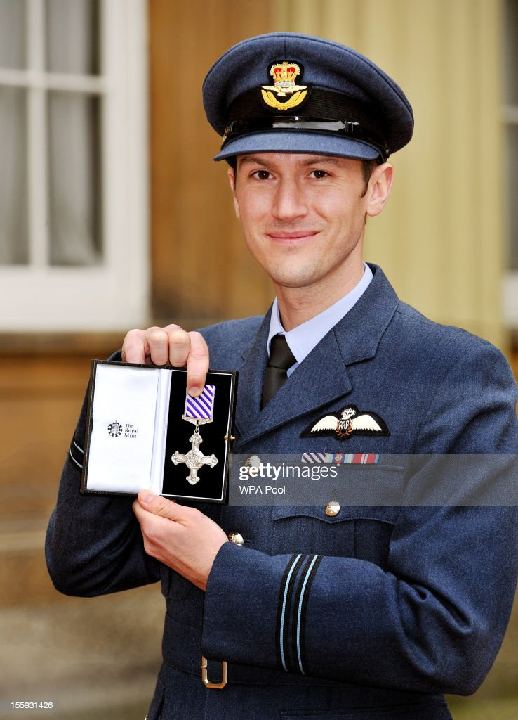 Flt Lt Daniel Cullen holds his DFC ( Distinguished Flying Cross), presented to him by Queen Elizabeth II at an investiture ceremony at Buckingham Palace on November 9, 2012 in London, England.