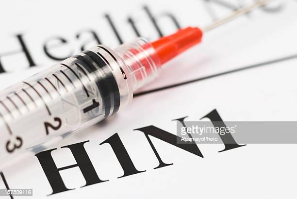 H1N1 Flu Shot, Vaccination close-up (red syringe) - I