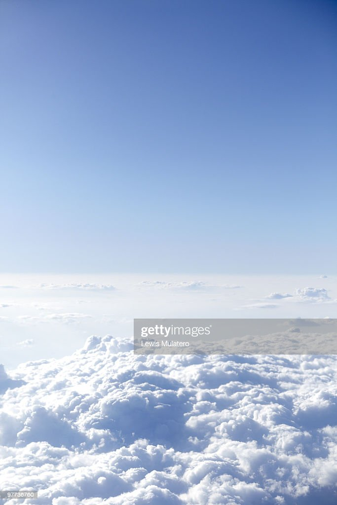 Fluffy clouds, view from airplane : Stock Photo