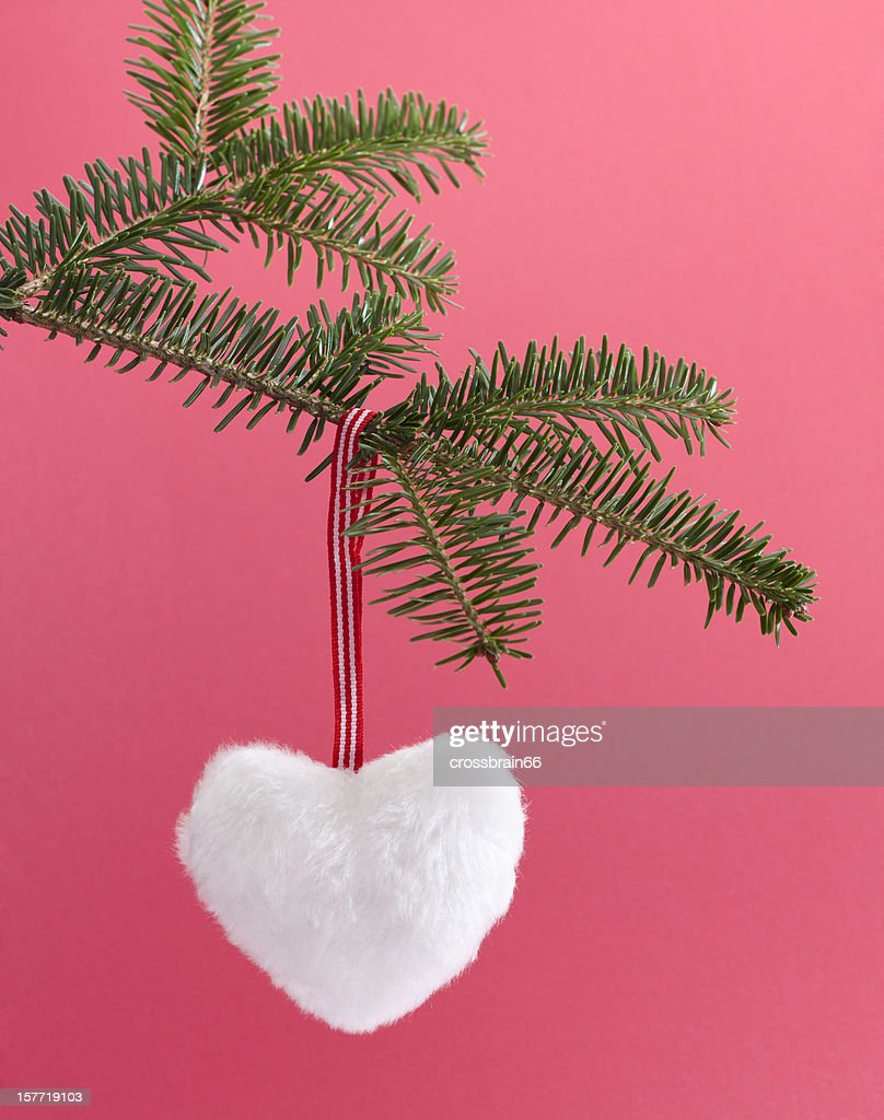 Fluffy white christmas heart on pink background : Stock Photo
