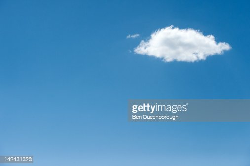A fluffy white cloud in blue sky