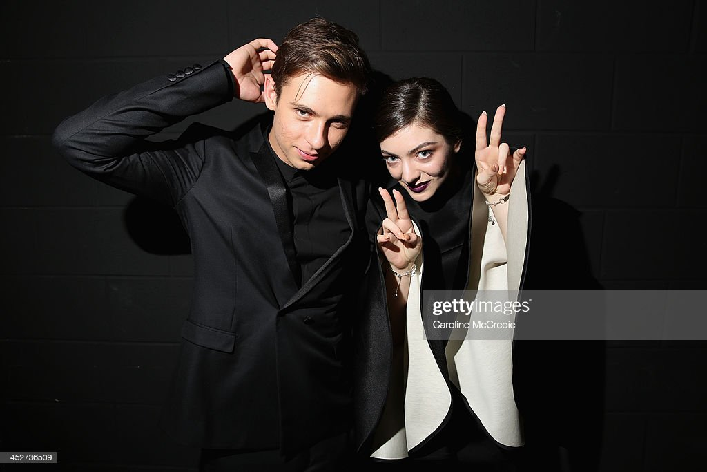 Flume and <a gi-track='captionPersonalityLinkClicked' href=/galleries/search?phrase=Lorde&family=editorial&specificpeople=3209104 ng-click='$event.stopPropagation()'>Lorde</a> pose backstage at the 27th Annual ARIA Awards 2013 at the Star on December 1, 2013 in Sydney, Australia.