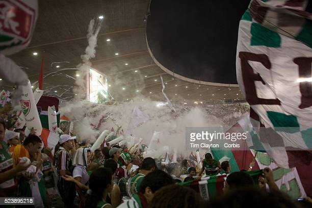 Fluminense fans throw rice powder as their team take the field before the Fluminense V Sao Paulo Futebol Brasileirao League match at the Jornalista...