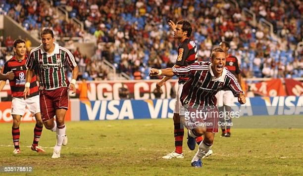 Fluminense striker Rodriguinho celebrates after scoring his sides third goal during the Flamengo V Fluminense Futebol Brasileirao League match at...