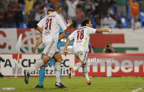 Fluminense's Wellington Nem celebrates after scoring against Santos FC during during their Brazilian Cup football match at the Joao Havelange stadium...