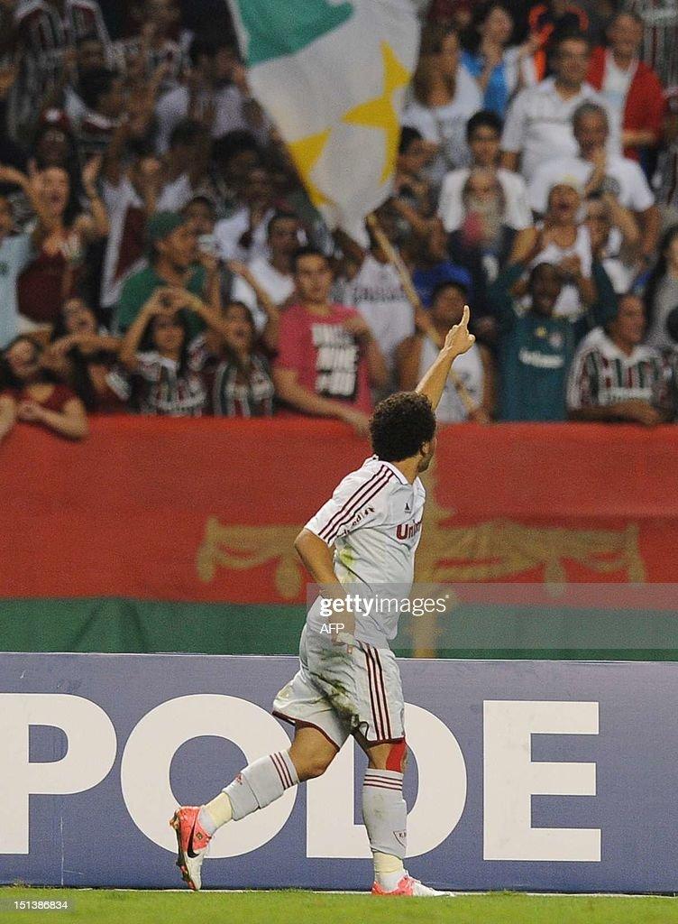 Fluminense's Wellington Nem celebrates after scoring against Santos FC during their Brazilian Championship football match at the Joao Havelange...