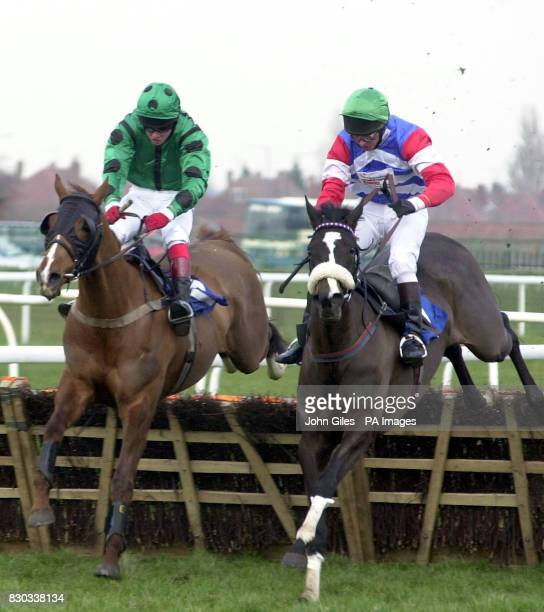 Flush ridden by jockey Noel Fehily beats Chicago Bear ridden by jockey Robert Thornton to win the Tete a Tete Selling Hurdle at Doncaster Races