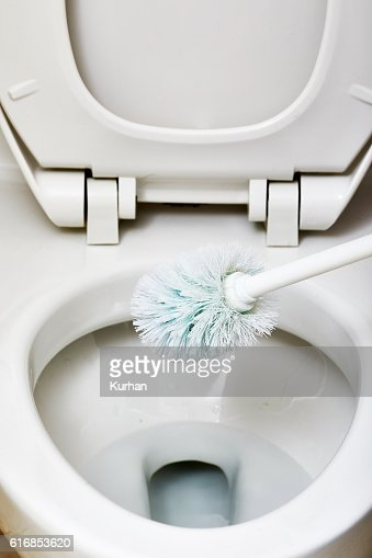Flush toilet bowl cleaning. : Stock Photo