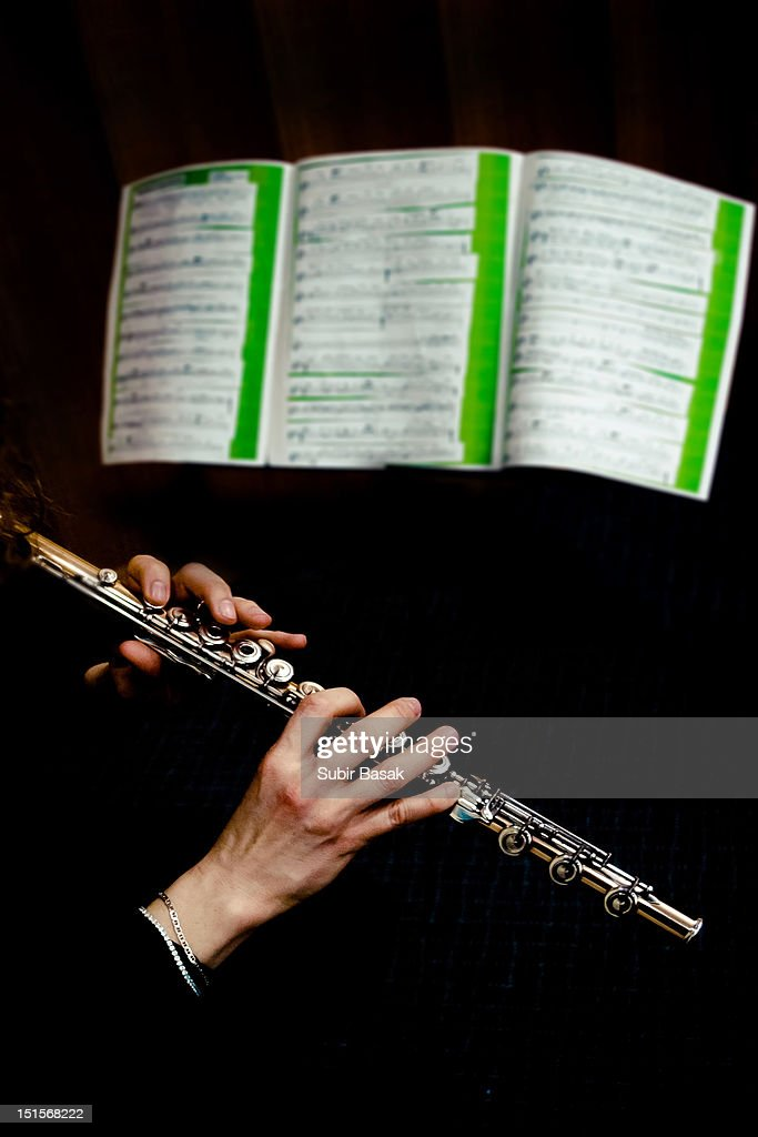 Flute Player perform infront of music sheet : Stock Photo