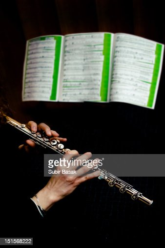 Flute Player perform infront of music sheet : Stockfoto