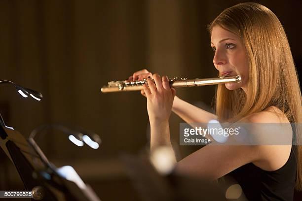 Flutist performing
