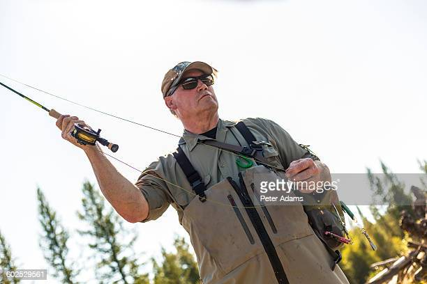 Fly fisherman casting & fishing, British Colombia