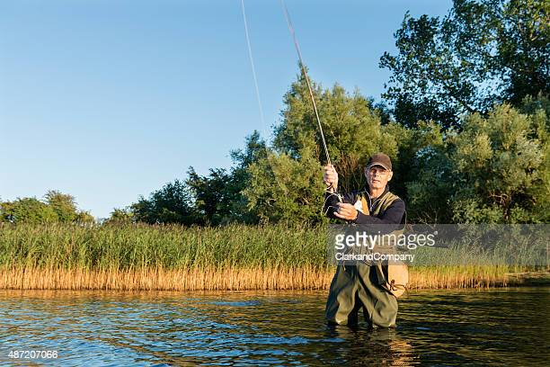 Fly Fisherman Casting Out His Line