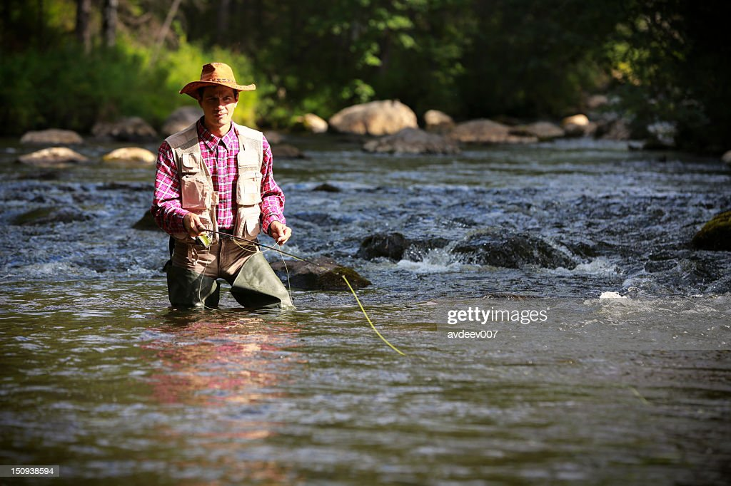 Fly fisherman : Stock Photo
