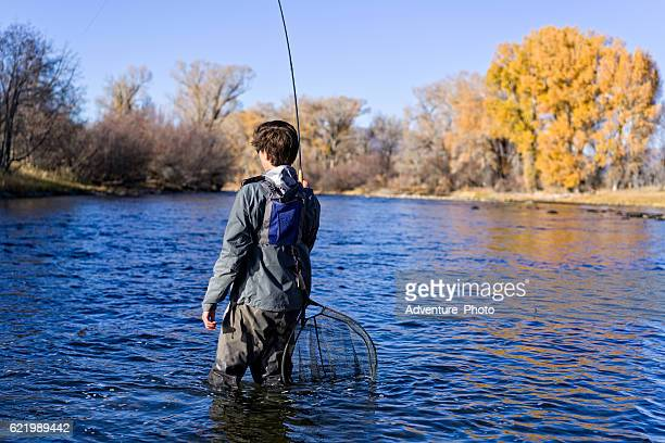 Fly Fisherman with Fish on Rod