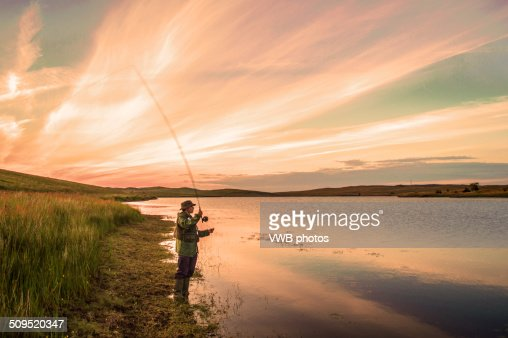 Fly fishing at sunset loch thom clyde muirshiel stock for Fly fishing photography