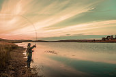 Fly fishing at Sunset, Loch Thom