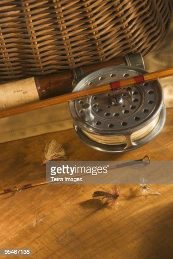 Antique fishing rods stock photos and pictures getty images for Used fly fishing gear for sale