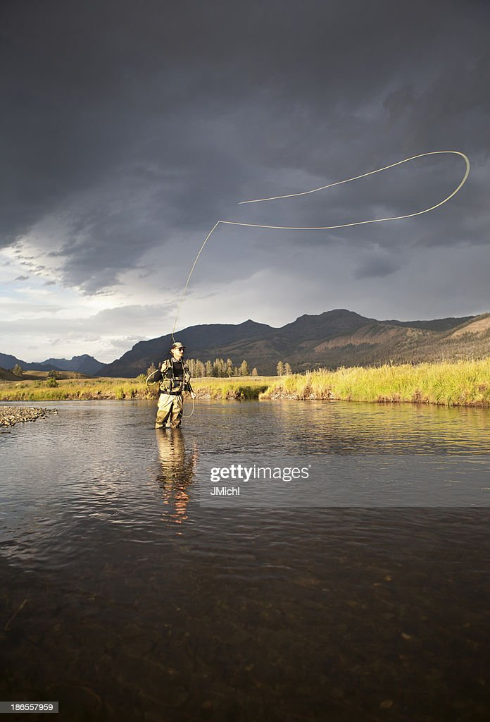 Fly Fishing For Trout on a Western United States River.
