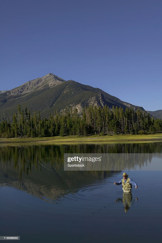 Fly Fishing In Lake With Mountain View Stock Photo