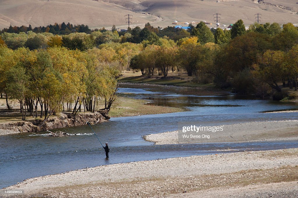 Fly fishing in Mongolia : Stock Photo