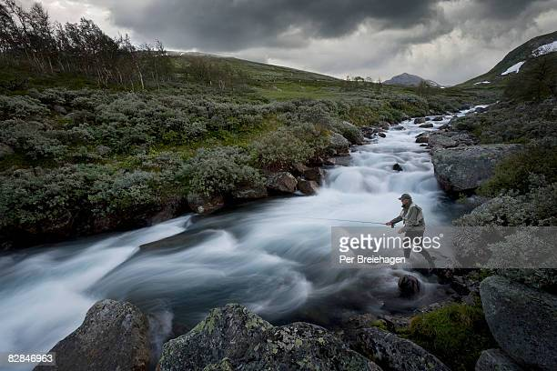 fly fishing in mountain stream