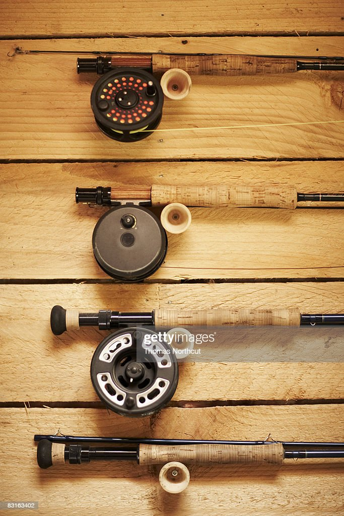 Fly fishing reels hanging on wall : Stock Photo