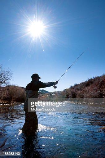 Pesca de silhueta de correr