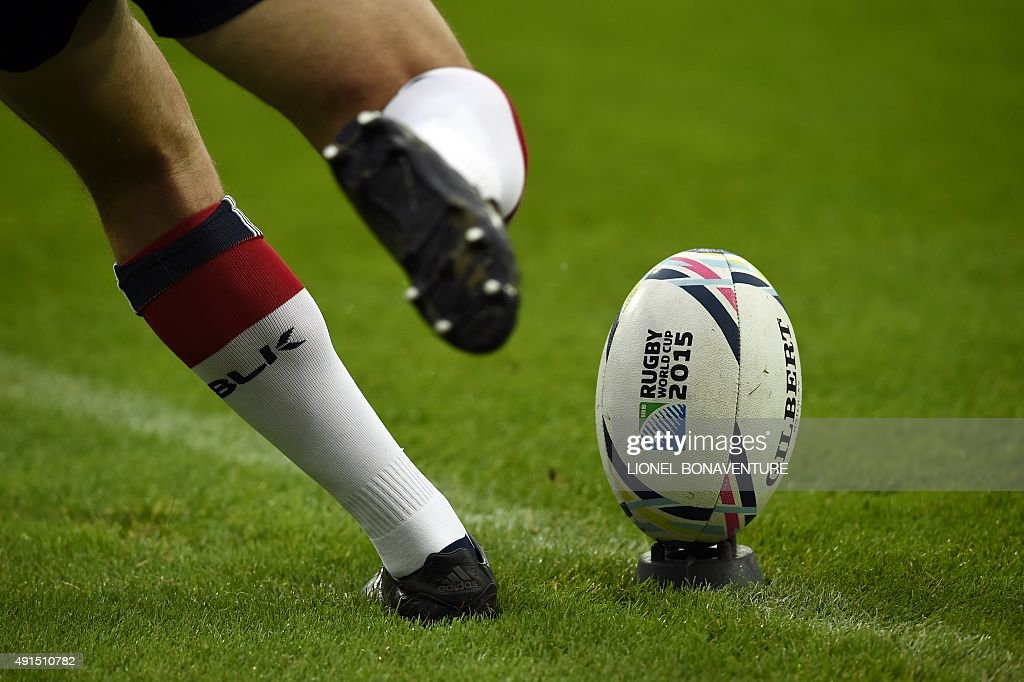 US fly half AJ MacGinty kicks the ball during the captain's run training session at the Olympic stadium in London on October 6 2015 on the eve of...