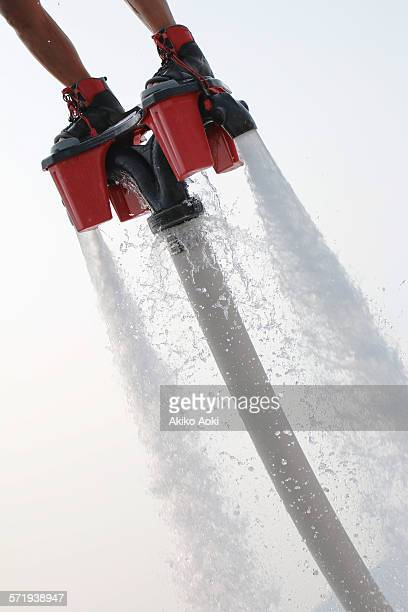 Flyboarding with water jetting.