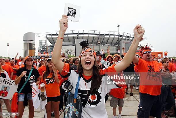 Flyer fans cheer at a block party prior to the start of Game Four of the 2010 NHL Stanley Cup Final between the Philadelphia Flyers and the Chicago...