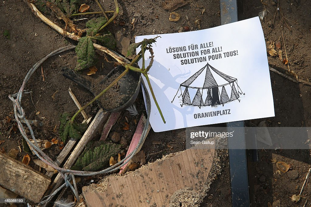 A flyer is among detritus lying on the ground at the former temporary refugee camp at Oranienplatz in Kreuzberg district after riot police sealed it off on April 8, 2014 in Berlin, Germany. Several hundred riot police sealed off the square after, according to an eyewitness, violence broke out between refugees who had accepted a deal by the city to leave the camp and a small number who insisted on staying. Refugees, many of them from Africa who came to Germany via Lampedusa, began dismantling their shelters today after many of them agreed to a deal with city authorities to move to a renovated hostel. Not all of the several hundred refugees, some of whom have been living at the Oranienplatz camp almost a year, have agreed to the deal, and while some said they will go elsewhere, some insisted they will stay, despite a city order to vacate.