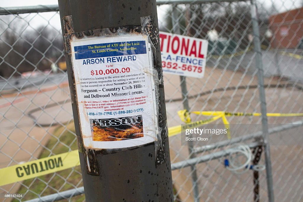 A flyer promises a reward for information about arson fires that destroyed businesses during November rioting on March 13 2015 in Dellwood Missouri...