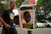 A flyer with a picture of Eric Garner is seen near where he was killed in an encounter with an NYPD officer in July on August 22 2014 in the borough...