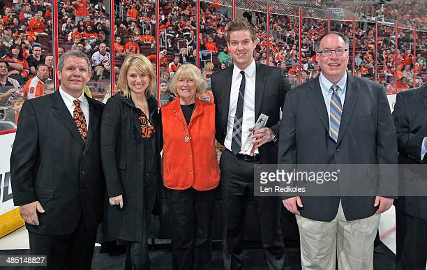 Flyers Fan Club president Joe Fisher and Fan Club member Paul Mazzochetti along with Lauren Hart and Sarah Hart present Steve Mason of the...
