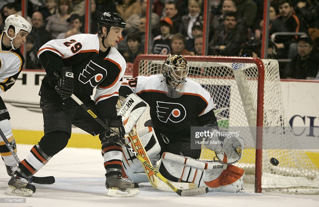 Flyers goalie Antero Niittymaki attempts to make a save on a second period Boston goal at the Wachovia Center. Boston Bruins vs Philadelphia Flyers. Thursday, January 19th, 2006