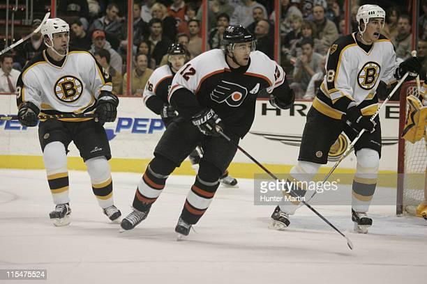 Flyers left winger Simon Gagne skates to the puck as Bruins Travis Green and Ian Moran pursue at the Wachovia Center Boston Bruins vs Philadelphia...