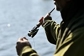 A flyfisherman casts his line at Bewl Water in Lamberhurst Kent southeast England on April 16 2014 Set in 800 acres of the Kent countryside Bewl...