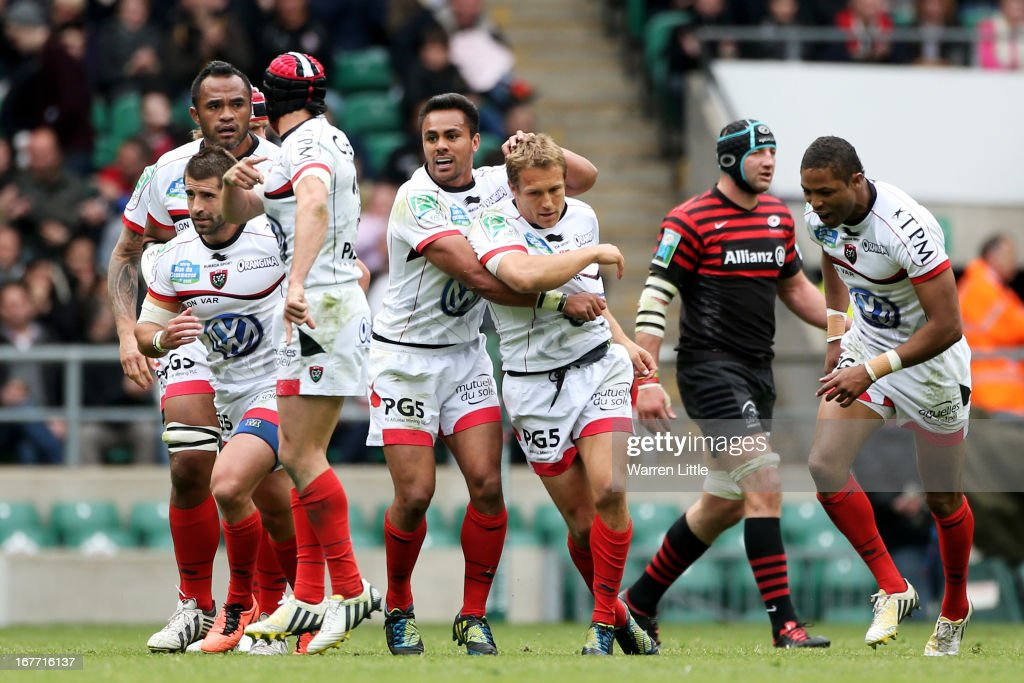 Flyhalf <a gi-track='captionPersonalityLinkClicked' href=/galleries/search?phrase=Jonny+Wilkinson&family=editorial&specificpeople=159417 ng-click='$event.stopPropagation()'>Jonny Wilkinson</a> of Toulon is congratulated by teammate <a gi-track='captionPersonalityLinkClicked' href=/galleries/search?phrase=Rudi+Wulf&family=editorial&specificpeople=818216 ng-click='$event.stopPropagation()'>Rudi Wulf</a> of Toulon after kicking a drop goal during the Heineken Cup semi final between Saracens and Toulon at Twickenham Stadium on April 28, 2013 in London, United Kingdom.