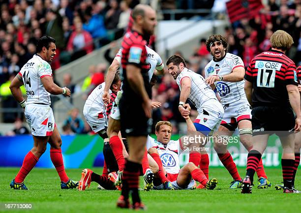 Flyhalf Jonny Wilkinson of Toulon is congratulated by teammates after kicking a drop goal during the Heineken Cup semi final between Saracens and...
