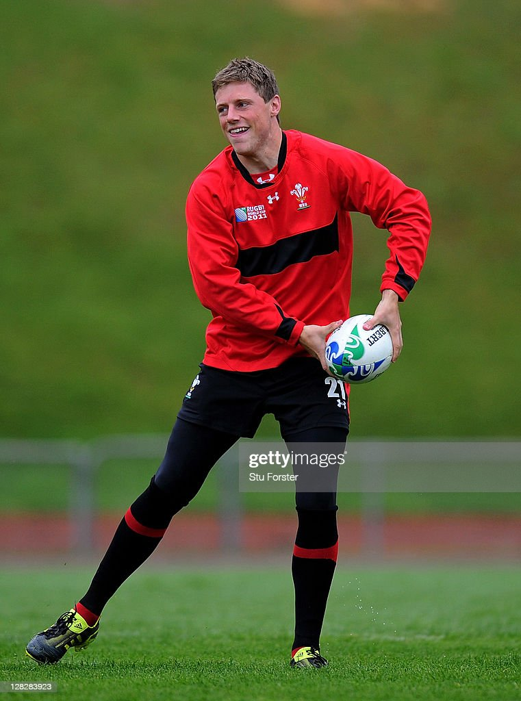 Flyhalf <a gi-track='captionPersonalityLinkClicked' href=/galleries/search?phrase=Rhys+Priestland&family=editorial&specificpeople=4195648 ng-click='$event.stopPropagation()'>Rhys Priestland</a> passes the ball during a Wales IRB Rugby World Cup 2011 training session at Newtown Park on October 6, 2011 in Wellington, New Zealand.