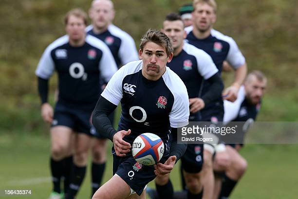 Flyhalf Toby Flood passes the ball during the England training session at Pennyhill Park on November 15 2012 in Bagshot England
