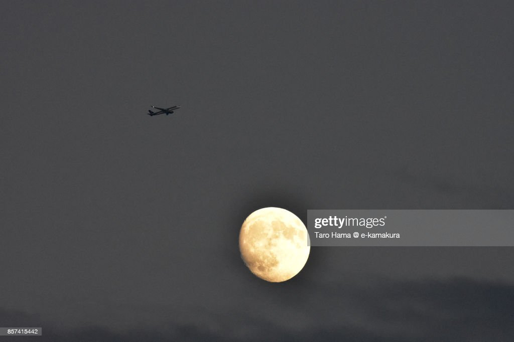 Flying airplane and moon : ストックフォト