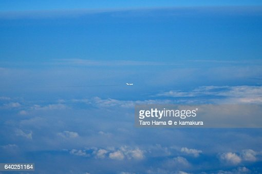 A flying airplane in blue sky