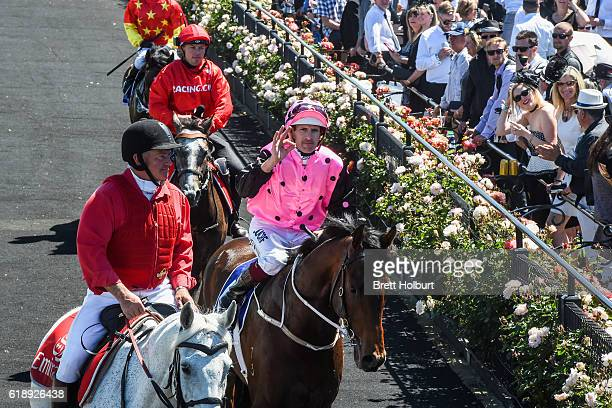 Flying Artie ridden by Hugh Bowman returns to the mounting yard after winning Coolmore Stud Stakes at Flemington Racecourse on October 29 2016 in...