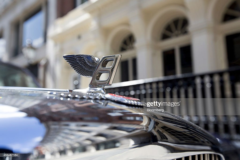 A 'Flying B' hood ornament sits on the bonnet of a Bentley luxury automobile as it stands parked outside buildings that form part of the Pollen Estate, on Cork Street in London, U.K., on Monday, Aug. 11, 2014. Norway's sovereign wealth fund, Norges Bank Investment Management, the world's largest, bought a stake in the Pollen Estate in London's Mayfair district for 343 million pounds ($576 million), expanding its property holdings in the U.K. capital. Photographer: Jason Alden/Bloomberg via Getty Images