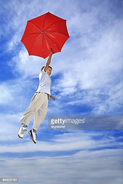 Flying Junge mit Schirm